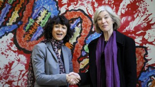 FILE PHOTO: French microbiologist Emmanuelle Charpentier (L) and professor Jennifer Doudna of the U.S. pose for the media during a visit to a painting exhibition by children about the genome, at the San Francisco park in Oviedo
