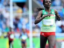 160812 RIO DE JANEIRO Aug 12 2016 Ethiopia s Tirunesh Dibaba crosses the finishline durin