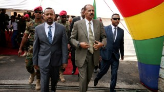 FILE PHOTO: Eritrea's President Isaias Afwerki and Ethiopia's Prime Minister, Abiy Ahmed arrive for an inauguration ceremony marking the reopening of the Eritrean embassy in Addis Ababa