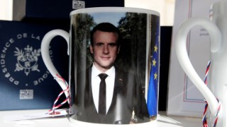 A mug with a picture of French President Macron and the Elysee Palace logo to launch the presidential brand named ''Elysee Presidence de la Republique'' is seen in the courtyard of the Elysee Palace as part of the European Heritage Days event in Paris