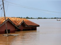 A house partially submerged in flood waters is pictured  in Lokoja city