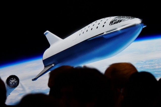 SpaceX CEO Elon Musk shows how the new BFR works during a press conference announcing the worldâÄÖs first private passenger scheduled to fly around the Moon aboard SpaceXâÄÖs BFR launch vehicle, at the company's headquarters in Hawthorne