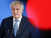 German Interior Minister Horst Seehofer addresses a news conference a in Berlin