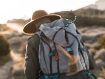 Italy Sardinia back view of hiker with backpack model released Symbolfoto PUBLICATIONxINxGERxSUIxA