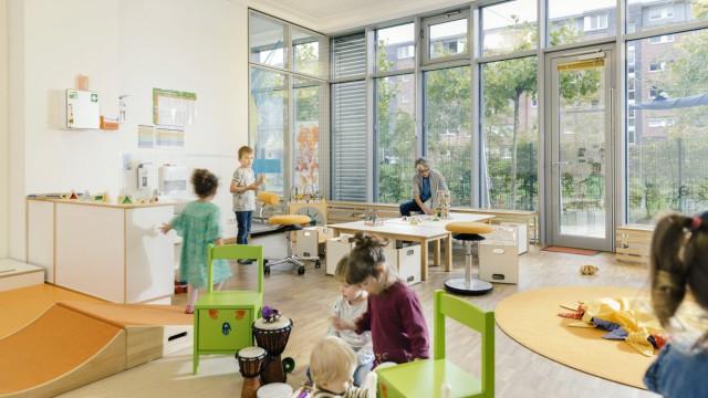 Pre school teacher and children in playing in learning room in kindergarten model released Symbolfo