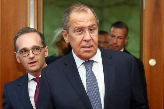 German Foreign Minister Heiko Maas and his Russian counterpart Sergei Lavrov arrive at a news conference at the foreign ministry in Berlin