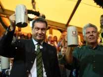 Munich mayor Dieter Reiter and Bavarian State Prime MinisterMarkusSoeder toast with beers at the opening day of the 185th Oktoberfest in Munich