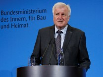 German Interior Minister Horst Seehofer addresses the media at the chancellery in Berlin