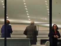 German Finance Minister Scholz, German Chancellor Merkel, Interior Minister Seehofer and Nahles, leader of SPD, are pictured through a window as leave a meeting, at the chancellery in Berlin