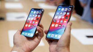 FILE PHOTO: A demonstration of the newly released Apple products is seen following the product launch event in Cupertino