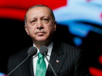 Turkish President Tayyip Erdogan speaks at a ceremony to mark Veterans' Day at the Presidential Palace in Ankara