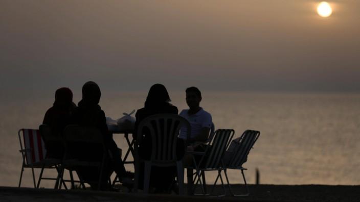May 21 2018 Gaza City Gaza Strip Palestinian Territory A Palestinian family gathers at the be