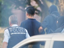 Men suspected of forming a far-right militant organisation in Chemnitz, are escorted by special police in front of the General Prosecutor's Office at the German Federal Supreme Court in Karlsruhe