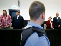 A court officer stands between defendant Wilfried Wagener and his former wife Angelika before their verdict at a local court in Paderborn