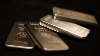 Platinum bars are stacked at the safe deposit boxes room of the ProAurum gold house in Munich