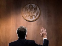 FILE PHOTO: Judge Brett Kavanaugh is sworn in before the U.S. Senate Judiciary Committee on Capitol Hill in Washington