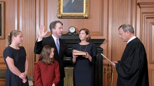 Judge Brett Kavanaugh is sworn in as an Associate Justice of the U.S. Supreme Court by Chief Justice John Roberts at the Supreme Court in Washington