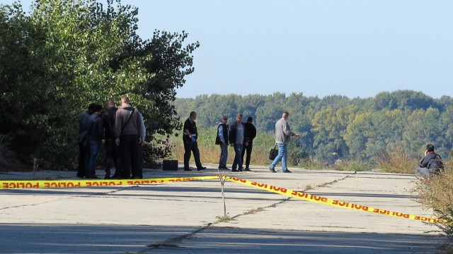 Police investigators walk near a crime scene where TV journalist Viktoria Marinova was murdered in Ruse