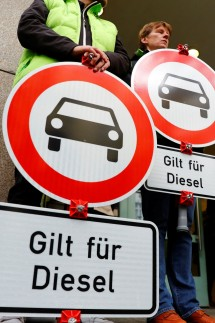 Environmental activists protest in front of a court before a court hearing on case seeking diesel cars ban in Berlin