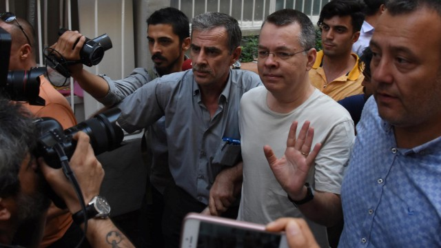 U.S. pastor Andrew Brunson reacts as he arrives at his home after being released from the prison in Izmir