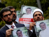 FILE PHOTO: Human rights activists and friends of Saudi journalist Khashoggi hold his pictures during a protest outside the Saudi Consulate in Istanbul