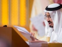 FILE PHOTO: Saudi Arabia's King Salman bin Abdulaziz Al Saud talks during the opening of 29th Arab Summit in Dhahran