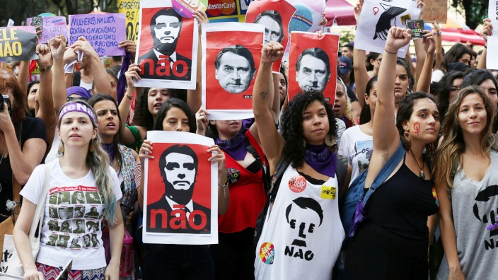 People demonstrate against presidential candidate Jair Bolsonaro in Rio de Janeiro