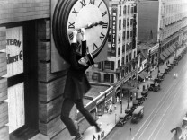 Harold Clayton Lloyd hangs from a clock in Safety Last 1923 Lloyd 1893 - 1971 was an American a