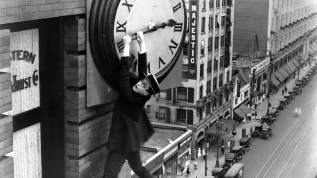 Harold Clayton Lloyd hangs from a clock in Safety Last 1923 Lloyd 1893 - 1971 was an American a