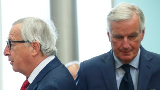 EU's chief Brexit negotiator Barnier and EU Commission President Juncker attend the EU Commission's weekly College meeting in Brussels