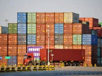 Truck transports a shipping container at Qingdao port in Shandong