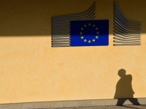The shadow of a worker is seen beside the EU Commission building in Brussels, Belgium