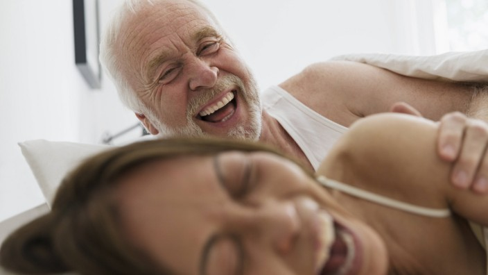 Playful affectionate senior couple in bed Playful affectionate senior couple in bed PUBLICATIONxI