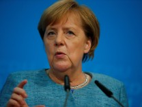 German Chancellor Angela Merkel gives a statement after leadership meeting at the CDU headquarters in Berlin
