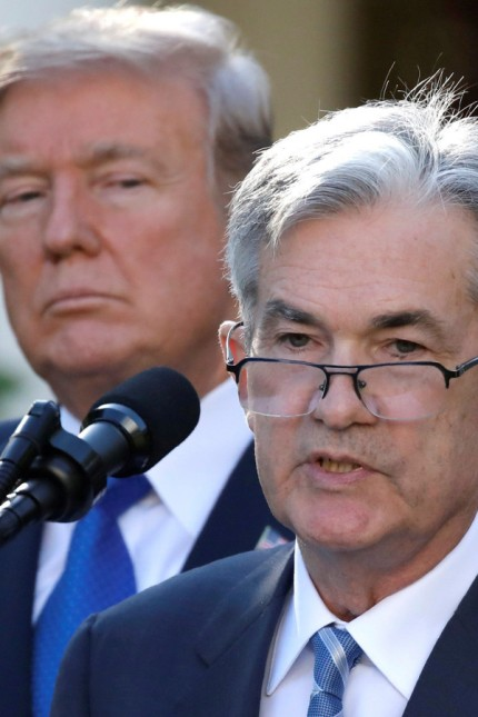 FILE PHOTO: U.S. President Donald Trump looks on as Jerome Powell, his nominee to become chairman of the U.S. Federal Reserve, speaks at the White House in Washington
