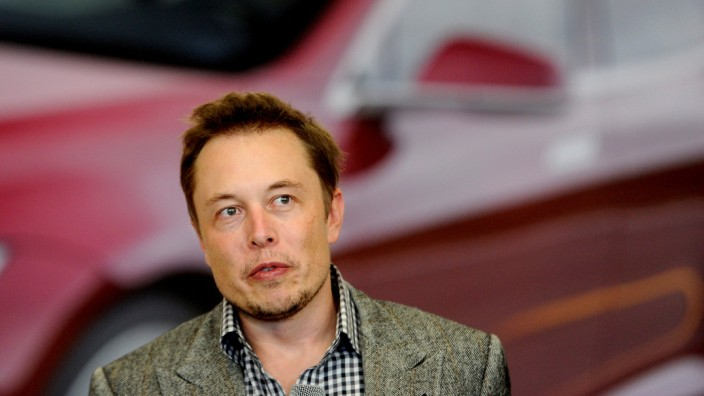 FILE PHOTO: Tesla Chief Executive Office Elon Musk speaks at his company's factory in Fremont