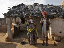 Ram and his wife Champa display their UID cards outside their hut at Merta district in Rajasthan