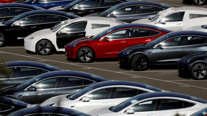 FILE PHOTO: Rows of the new Tesla Model 3 electric vehicles in Richmond