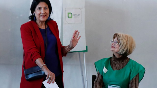 Pro-government presidential candidate Zurabishvili casts her ballot at a polling station during presidential election in Tbilisi