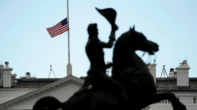 The flag of the United States flies at half staff in mourning for 11 people who were shot to death at a synagogue in Pittsburgh, at the White House in Washington
