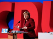 FILE PHOTO: German Chancellor and leader of the Christian Democratic Union Merkel makes a closing statement during the second day of the CDU party congress in Karlsruhe