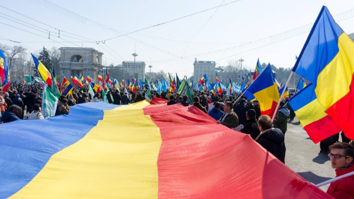 CHISINAU MOLDOVA MARCH 25 2018 People take part in a rally for the unification of Moldova and R