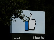 FILE PHOTO: The entrance sign to Facebook headquarters is seen in Menlo Park