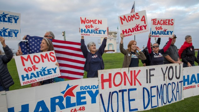 Supporters rally for Democratic 48th congressional district candidate Harley Rouda at Main Street Park on the morning of the midterm elections, in Laguna Beach