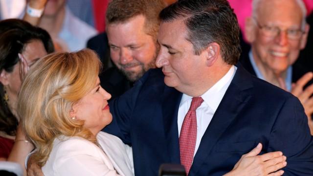 Republican U.S. Senator Ted Cruz hugs his wife Heidi Cruz during his election night party in Houston