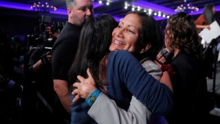 U.S. Democratic Congressional candidate Deb Haaland hugs a supporter after winning her midterm election in Albuquerque
