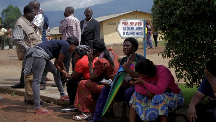 Parents await for news of their children at a school where 79 pupils were kidnapped in Bamenda