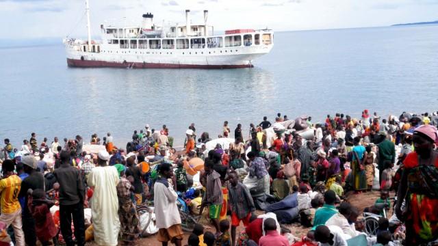Burundian refugees wait at the shores of Lake Tanganyika in Kagunga village in Kigoma region, western Tanzania, as MV Liemba arrives to transport them to Kigoma township