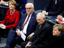 German Chancellor Angela Merkel and German President Frank-Walter Steinmeier's arrive at Berlin's Reichstag to mark the 100th anniversary of the Weimar Republic, in Berlin