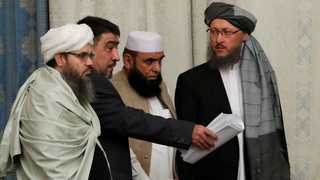 Members of Taliban delegation take their seats during the multilateral peace talks on Afghanistan in Moscow